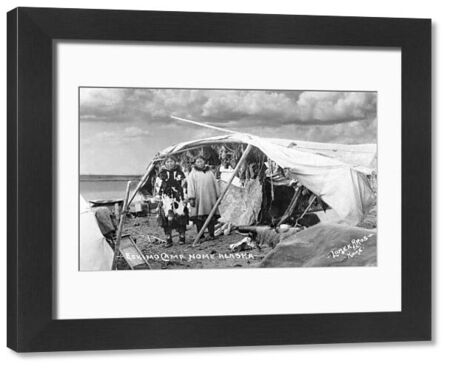 ALASKA: ESKIMOS, c1916.   Two Eskimo women standing in front of a tent in their camp in Nome, Alaska. Photographed by the Lomen Brothers, c1916