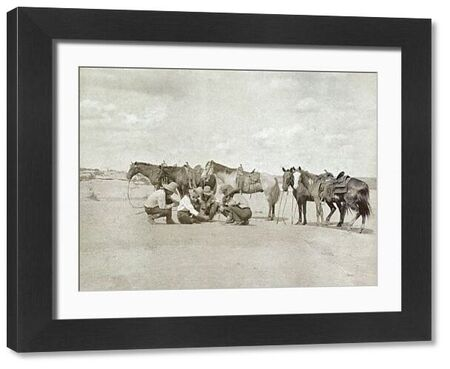 TEXAS: COWBOYS, c1907.   Five cowboys gathered together as one of them draws a map on the ground beside their horses, Texas. Photograph by Erwin Evans Smith, c1907