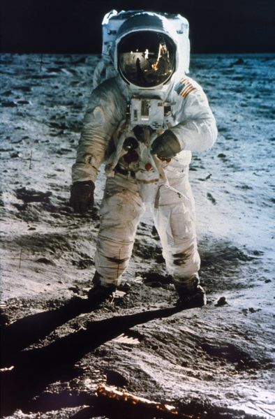 APOLLO 11: BUZZ ALDRIN.  Astronaut Edwin 'Buzz' Aldrin standing on moon. Neil Armstrong and Eagle reflected in his visor, 20 July 1969