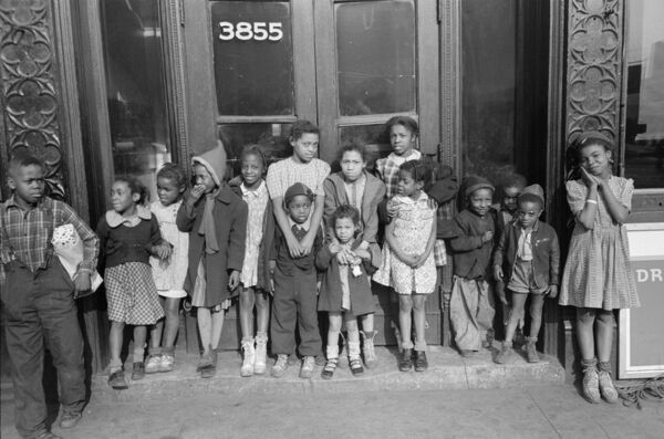 CHICAGO: CHILDREN, 1941.   Group of African American children outside a building on the South Side of Chicago, Illinois. Photograph by Edwin Rosskam, April 1941