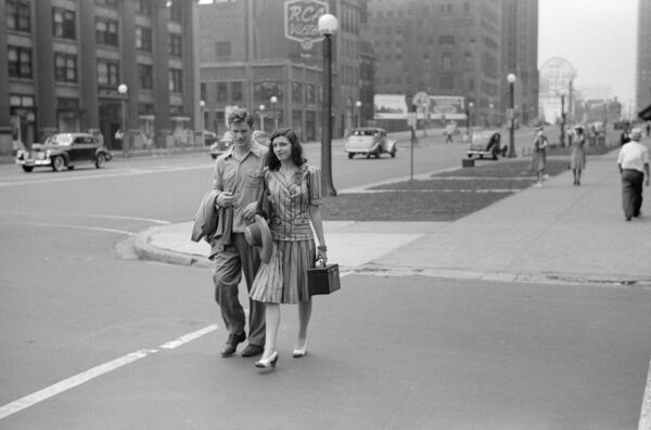 CHICAGO: COUPLE, 1941.   A young couple on Michigan Avenue in Chicago, Illinois. Photograph by John Vachon, July 1941
