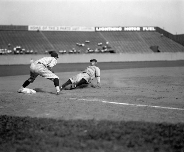 GEORGE H. RUTH (1895-1945).  Known as Babe Ruth. American baseball player for the New York Yankees. Ruth safely sliding into third base during a game against the Washington Senators, 1925. The Senator's third baseman is Ossie Bluege