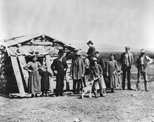 IDAHO: SETTLERS, c1882.   A group of settlers standing outside a log cabin in American Falls, Idaho. Photographed c1882