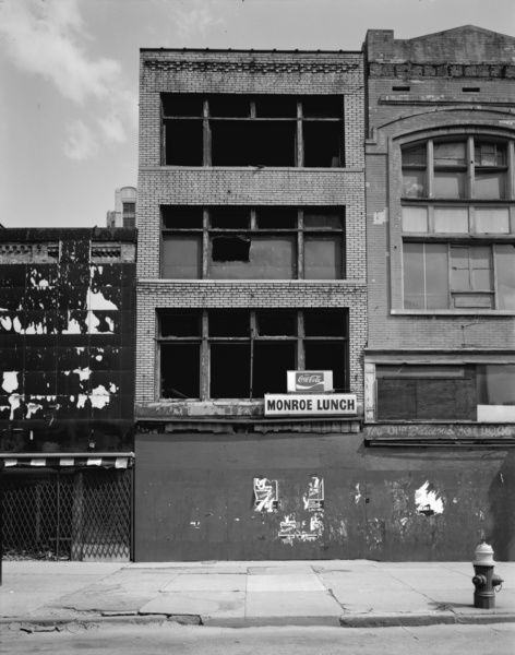 MICHIGAN: DETROIT, c1980.   Abandoned storefronts along Monroe Street in Detroit, Michigan. Photograph, c1980