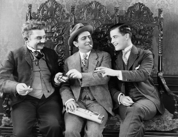 SILENT FILM STILL: SMOKING.  Ernest Lubitsch, Ramon Novarro and Jean Hersholt in 'Old Heidelberg,' 1927