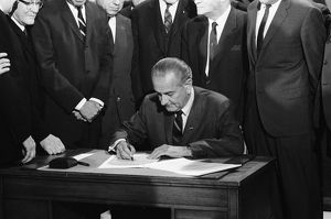 (1908-1973). 36th President of the United States. Johnson signing the Civil Rights Bill