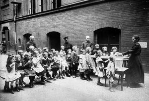 BERLIN: SALVATION ARMY. Salvation Army volunteer feeding Berlin children. Photograph