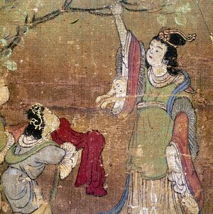 Buddha is born from the side of Queen Maya as she reaches up to a branch in her garden