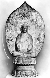 Buddha in meditation. White marble with traces of polychrome. Height: 64 in. Liao Dynasty