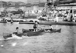 CANOE TILTING, c1910. A canoe tilting competition at the Colonial Yacht Club in America