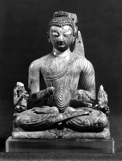 Carved ivory seated Buddha from India, 8th century.