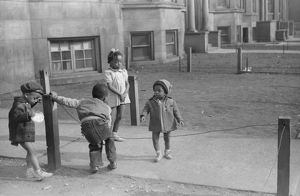 CHICAGO: CHILDREN, 1941. Children playing in front of an apartment building