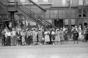 CHICAGO: COMMUTERS, 1940. Commuters waiting for a street car in Chicago, Illinois