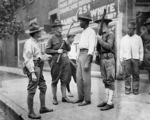 CHICAGO: RACE RIOT, 1919. National Guardsmen questioning an African American man