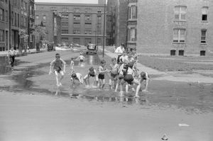 CHICAGO: SUMMER, 1941. Children cooling off from the summer heat in water