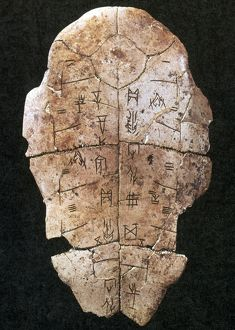 CHINA: ORACLE SHELL. A tortoise shell inscribed with Chinese characters during a divination ritual