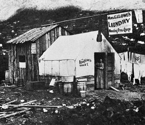DAWSON CITY, c1900. A laundress and fortune teller in the doorway of her shop in