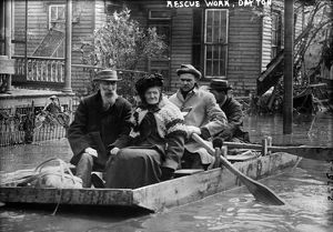 DAYTON FLOOD, 1913. Workers rescuing an elderly couple in a rowboat after the flood