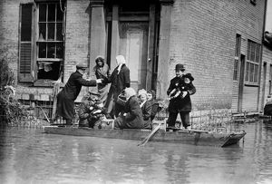 DAYTON FLOOD, 1913. Workers rescuing a family in a rowboat after the flood in Dayton, Ohio