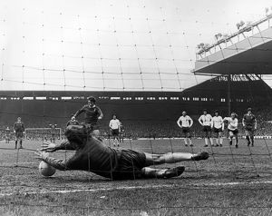 ENGLAND: SOCCER GAME, 1973. Pat Jennings of Tottenham Hotspur blocks a penalty kick