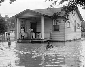 FLOOD, 1922. Children on the porch of a flooded house. Photograph, 2 September 1922