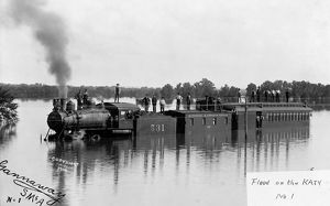 FLOOD, c1904. A train of the Missouri-Kansas-Texas Railroad under flood waters