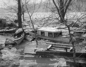 FLOOD, c1915. Boats and debris stuck in the ice of the Potomac River after a flood