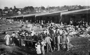 FLOOD REFUGEES, 1912. Flood refugees from Louisiana at a cotton compress being