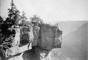GRAND CANYON, c1906. A man standing on the ledge of a limestone cliff overlooking