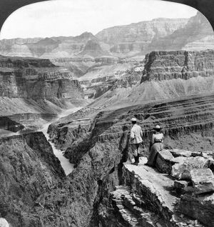 GRAND CANYON: SIGHTSEERS. A man and a woman looking out across the Granite Gorge