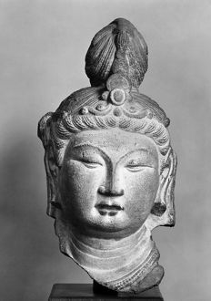 Head of a bodhisattava from the caves of T'ien Lung Shan, China. Sandstone, T'ang dynasty