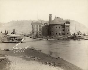 JOHNSTOWN FLOOD, 1889. A pontoon bridge across Conemaugh River in Johnstown, Pennsylvania