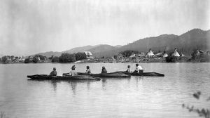 KALISPEL TRIBE, c1910. Native Americans in three canoes with their camp on the
