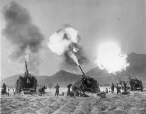 KOREAN WAR, 1951. United Nations artillerymen firing Eighth Army 155mm guns against