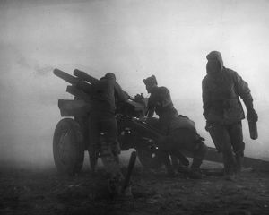 KOREAN WAR: ARTILLERY. U.S. Marine artillerymen firing in the fog on a North Korean