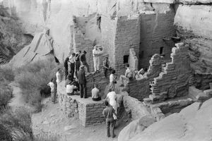 MESA VERDE: TOURISM, 1939. Tourists visiting cliff dwellings at Mesa Verde National Park