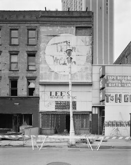 MICHIGAN: DETROIT, c1980. Abandoned storefronts along Monroe Avenue in Detroit, Michigan