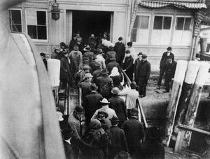 NEW YORK: BATTERY, 1902. Immigrants disembarking from the ferry boat from Ellis