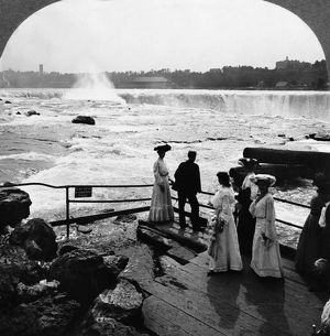 NIAGARA FALLS, c1903. Tourists view rapids from platform at Niagara Falls, stereograph