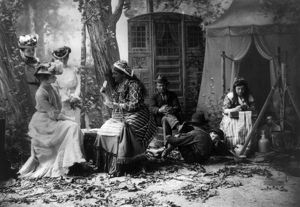 PALM READING, c1902. Staged depiction of three fashionable women having their fortunes