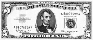 President Abraham Lincoln on the front of a U.S five dollar note, 1963.