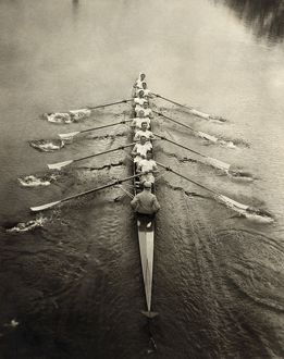 ROWING TEAM, c1913. The Cambridge rowing team on a river. Photograph, c1913