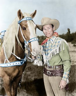 ROY ROGERS (1911-1998). Ne Leonard Slye. American singing cowboy actor. With his horse