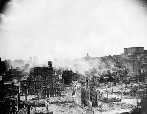 SAN FRANCISCO EARTHQUAKE. Aerial view of ruins, fire and smoke, following the earthquake