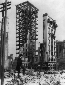 SAN FRANCISCO EARTHQUAKE. A man standing amid the rubble with an unfinished steel
