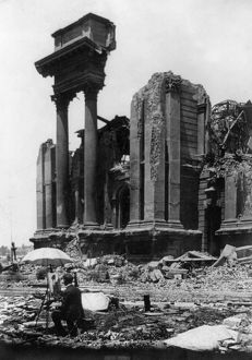 SAN FRANCISCO EARTHQUAKE. A painter amid the rubble painting the ruins of large buildings