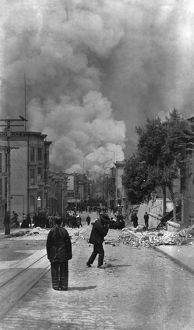 SAN FRANCISCO EARTHQUAKE. Pedestrians on the street with smoke from the burning