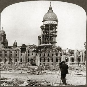 SAN FRANCISCO EARTHQUAKE. The ruins of City Hall with a photographer using a camera