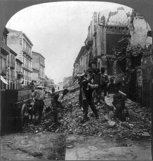 SICILY: EARTHQUAKE, c1909. Men clearing away the rubble on route to Catane, Messina