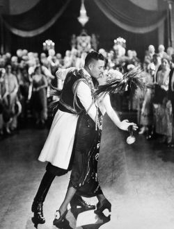 SILENT FILM STILL: DANCING.